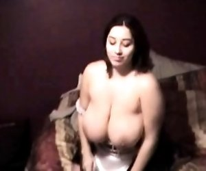 Busty maid massages oily...