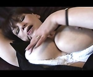 Busty hairy mature with...