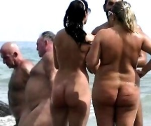 Nudist beach voyeur shoots...